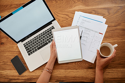 Buy stock photo High angle shot of an unrecognizable woman using a digital tablet while working at her desk at home
