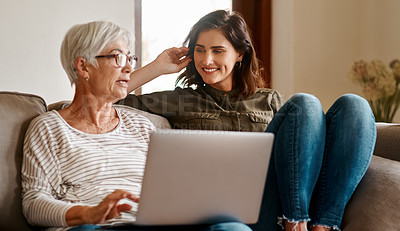 Buy stock photo Cropped shot of an affectionate senior woman having a conversation with her adult daughter while using a laptop in their living room at home