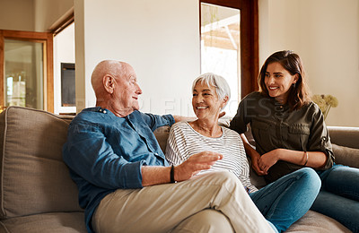 Buy stock photo Cropped shot of an affectionate senior man  spending time with his wife and adult daughter in their living room at home