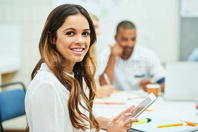 Buy stock photo Portrait of an attractive young designer using a digital tablet during a meeting with colleagues at work