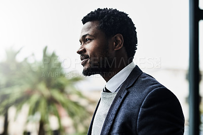 Buy stock photo Cropped shot of a handsome young business at his corporate office