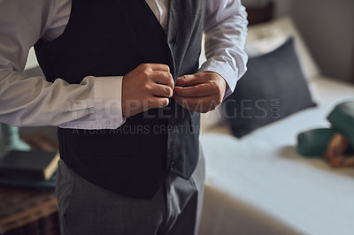 Buy stock photo Closeup shot of a young man getting dressed on his wedding day