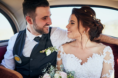 Buy stock photo Shot of a young couple travelling in a car on their wedding day]