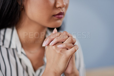 Buy stock photo Shot of an unrecognizable businesswoman clinching her hands and looking stressed out inside her office