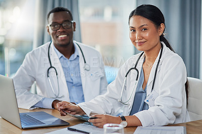 Buy stock photo Portrait of two doctors working together in a hospital