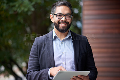 Buy stock photo Portrait of a mature businessman using a digital tablet outdoors