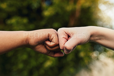 Buy stock photo Cropped shot of two unrecognizable people giving each other a fist bump