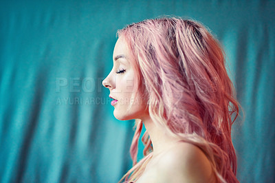 Buy stock photo Cropped shot of a beautiful young woman with pink hair against a blue background