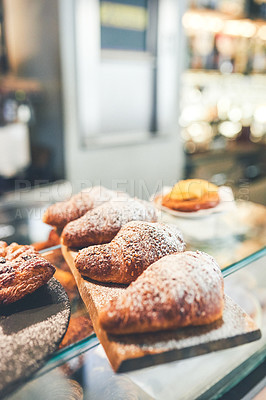 Buy stock photo Shot of a wooden board with four pastries placed on a wooden board inside of a coffee shop during the day