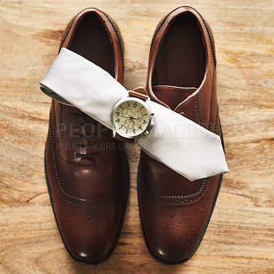 Buy stock photo Still life shot of a wristwatch and tie on top of formal shoes on a wooden surface