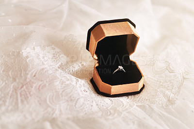 Buy stock photo Still life shot of a beautiful diamond ring inside a ring box top of wedding dress