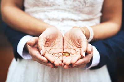Buy stock photo Cropped shot of an unrecognizable newlywed couple holding and showing their rings on their wedding day