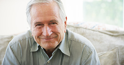 Buy stock photo Portrait of a happy senior man relaxing on the sofa at home