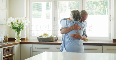 Buy stock photo Shot of a happy senior couple in a loving embrace at home