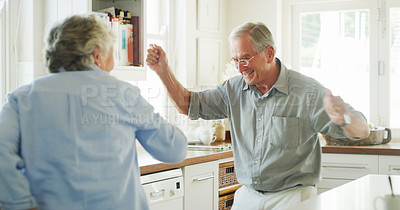 Buy stock photo Shot of a happy senior couple dancing together at home