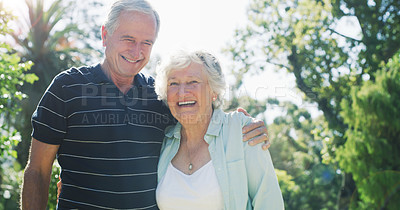 Buy stock photo Cropped shot of an affectionate senior couple smiling while standing together in a park during the day