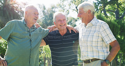 Buy stock photo Cropped shot of a group of male senior friends spending time together in a park during the day