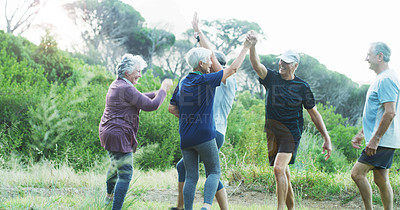 Buy stock photo Cropped shot of a group of cheerful senior friends celebrating while working out outdoors