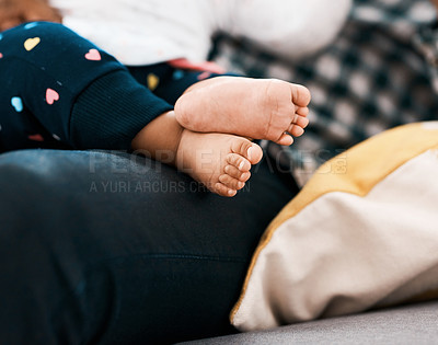 Buy stock photo Cropped shot of an unrecognizable man and his baby sitting at home