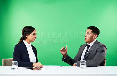 Buy stock photo Cropped shot of an attractive young female news anchor interviewing a guest while delivering the news against a green background