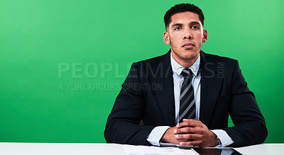 Buy stock photo Cropped shot of a handsome young male news anchor delivering the latest news against a green background