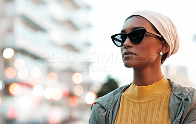 Buy stock photo Cropped shot of an attractive young woman wearing a hijab and sunglasses while touring the city