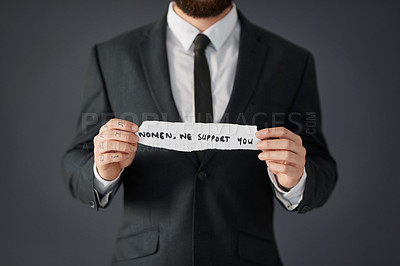 Buy stock photo Studio shot of an unrecognizable businessman holding a piece of paper written
