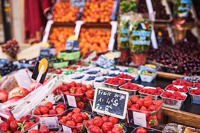 Buy stock photo Shot of delicious fresh strawberries for sale at a fruit stall in Paris, France