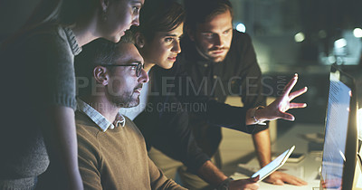 Buy stock photo Cropped shot of a diverse group of businesspeople using a computer together during a meeting in the office at night