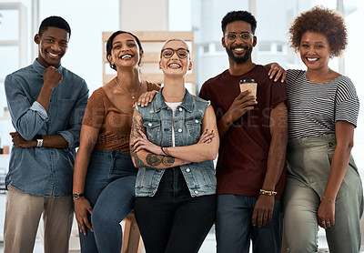 Buy stock photo Portrait of a group of creative young businesspeople posing together inside a modern office