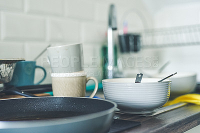 Buy stock photo Shot of a kitchen sink full of dirty dishes at home