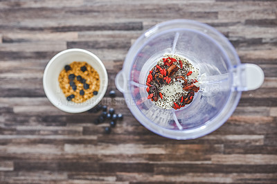 Buy stock photo High angle shot of ingredients for a smoothie in a blender