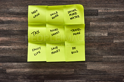 Buy stock photo Shot of sticky notes with various goals written on the stuck to a wall
