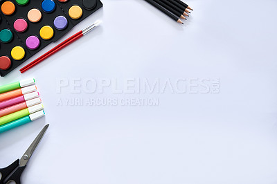 Buy stock photo High angle shot of blank paper surrounded by various artistic tools on a desk