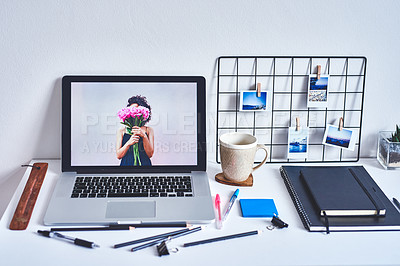 Buy stock photo Shot of a laptop and various other business tools on a work desk