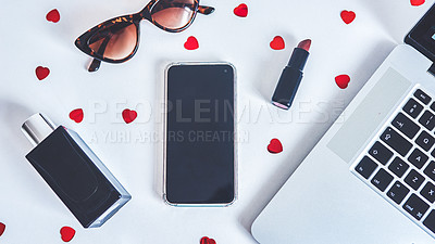 Buy stock photo Shot of a laptop and various other business tools related to beauty on a work desk