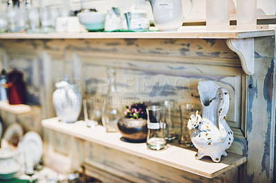 Buy stock photo Shot of various ceramic and glass goods on a shelf in a vintage store