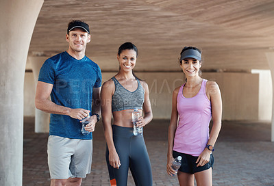 Buy stock photo Portrait of a group of three people standing together while out for a workout together