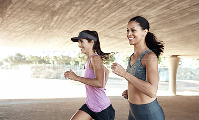Buy stock photo Shot of two women out for a run together