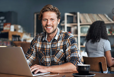 Buy stock photo Defocused shot of a man using his laptop while sitting in a cafe