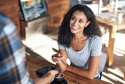 Buy stock photo Cropped shot of a female customer choosing to pay by card in a cafe