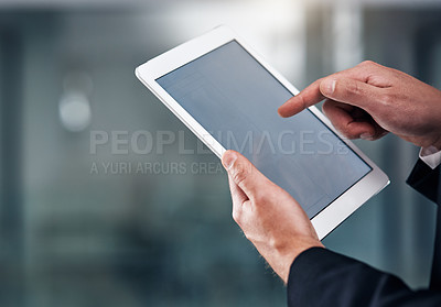 Buy stock photo Cropped shot of an unrecognisable businessmen using a digital tablet in a modern office