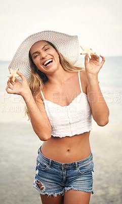 Buy stock photo Cropped portrait of an attractive young woman standing and playfully holding up star shaped pineapple pieces during a vacation