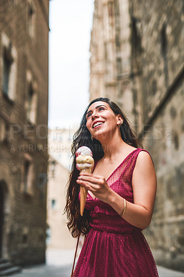 Buy stock photo Cropped shot of an unrecognizable woman holding an ice cream while touring the city of Barcelona alone