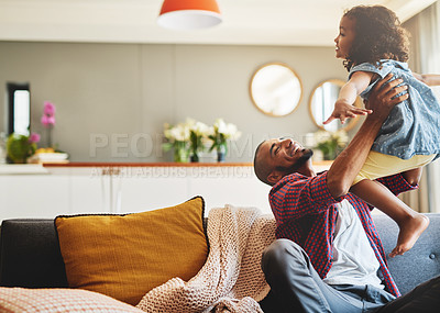 Buy stock photo Cropped shot of an affectionate young father lifting his daughter playfully in their living room at home