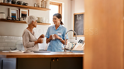 Buy stock photo Shot of a senior woman and a young nurse having tea while chatting in a retirement home