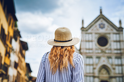 Buy stock photo Rearview shot of a woman exploring a foreign city