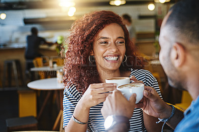 Buy stock photo Cropped shot of a happy young couple sitting together in a cafe and enjoy a coffee during a date