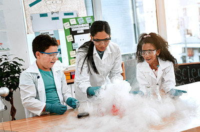 Buy stock photo Shot of an adorable little boy and girl conducting a scientific experiment with their teacher at school