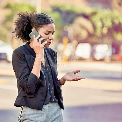 Buy stock photo Closeup shot of an attractive young businesswoman making a phone call in the city